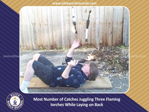 Most Number of Catches Juggling Three Flaming torches While Laying on Back