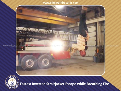 Fastest Inverted Straitjacket Escape while Breathing Fire